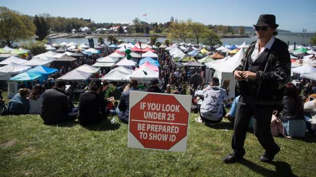A warning sign is seen posted at the annual 4/20 marijuana celebration in Vancouver on Saturday, April 20, 2019. (THE CANADIAN PRESS/Darryl Dyck)