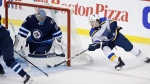 St. Louis Blues' Robert Thomas (18) attempts the wraparound on Winnipeg Jets goaltender Connor Hellebuyck (37) during first period NHL playoff action in Winnipeg on Thursday, April 18, 2019. There was no goal on the play. THE CANADIAN PRESS/John Woods