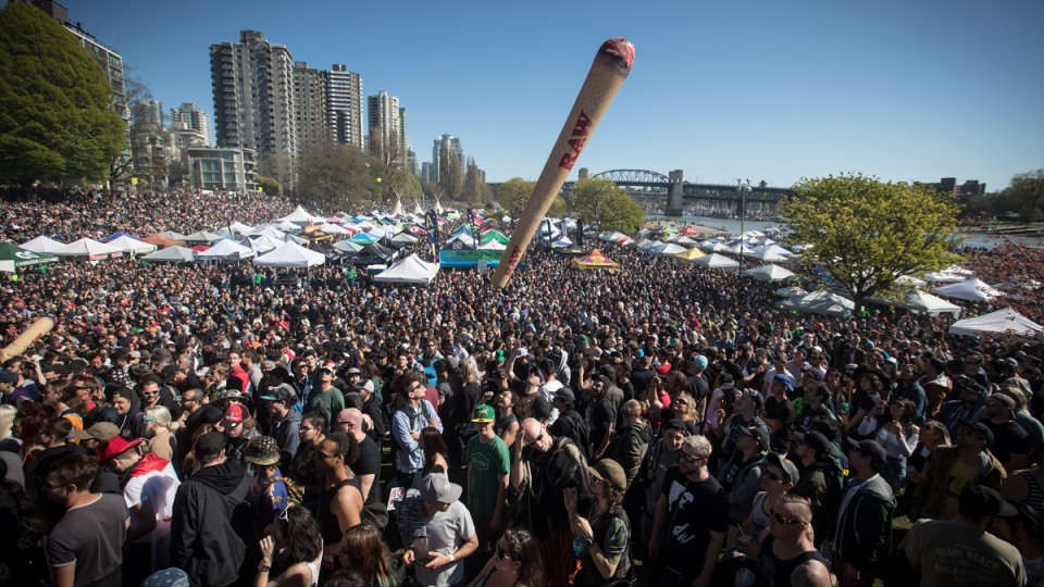 An inflatable shaped like a joint is tossed above the crowd during the annual 4/20 marijuana celebration in Vancouver on Saturday, April 20, 2019. THE CANADIAN PRESS/Darryl Dyck