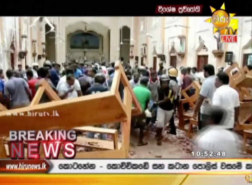 This image made from video provided by Hiru TV shows damage inside St. Anthony's Shrine after a blast in Colombo, Sunday, April 21, 2019. (Hiru TV via AP)