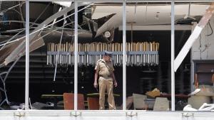 A Sri Lankan Police officer inspects a blast spot at the Shangri-la hotel in Colombo, Sri Lanka, Sunday, April 21, 2019. (AP Photo/Eranga Jayawardena)