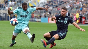 Montreal Impact's Daniel Lovitz, right, takes a shot past the reach of Philadelphia Union's Ray Gaddis during the second half of an MLS soccer match, Saturday, April 20, 2019, in Chester, Pa. The Union won 3-0. (AP Photo/Derik Hamilton)