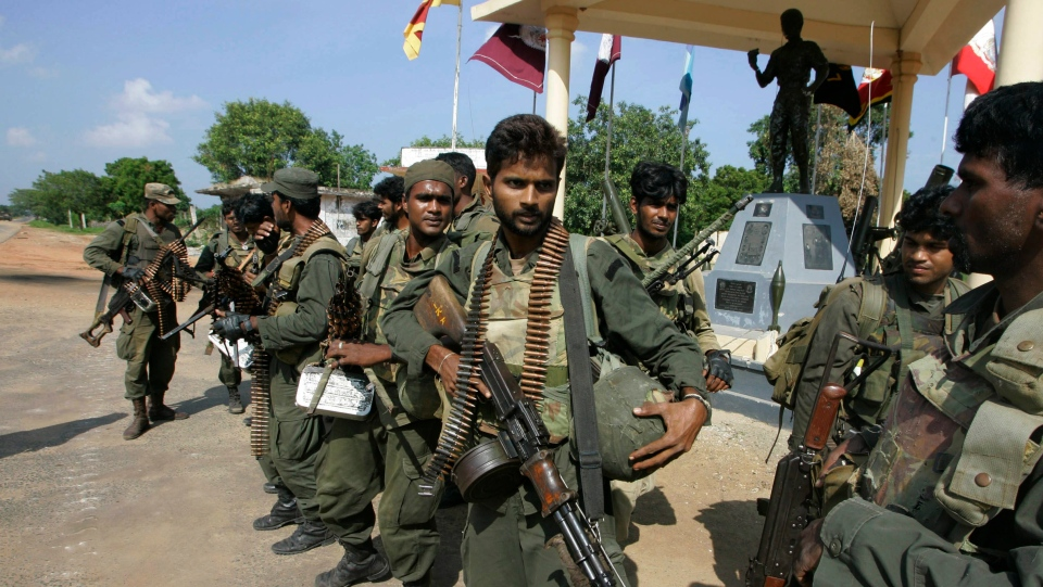 In this file photo, Sri Lankan army soldiers get ready to leave for the front line of the war zone from Paranthan in Killinochchi area, about 240 kilometers (150 miles) north of Colombo, Sri Lanka, Sunday, Jan. 4, 2009. (AP Photo/Eranga Jayawardena)