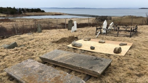 "The All Saints cemetery in Conception Bay South, N.L. is seen in this undated handout photo. Some graves date back to the 1850s, but the historic cemetery has been the subject of much recent attention after a bizarre crime that has had the island abuzz. Police cars and medical examiners were on site last weekend assessing the scene, after the grave was tied to the discovery of ""quite old"" skeletal remains on a nearby recreational trail. (THE CANADIAN PRESS/HO)"