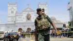 Sri Lankan Army soldiers secure the area around St. Anthony's Shrine after a blast in Colombo, Sri Lanka, Sunday, April 21, 2019. (AP Photo/Eranga Jayawardena