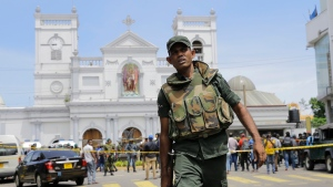 Sri Lankan Army soldiers secure the area around St. Anthony's Shrine after a blast in Colombo, Sri Lanka, Sunday, April 21, 2019. (AP Photo/Eranga Jayawardena