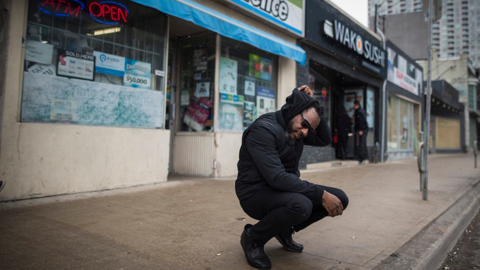 Dion Fitzgerald is photographed along the corner where he first witnessed the aftermath of the 2018 van attack while out on his lunch break, along Yonge Street in Toronto on Thursday, April 11, 2019. THE CANADIAN PRESS/Tijana Martin