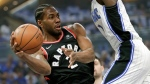 Toronto Raptors' Kawhi Leonard, left, passes the ball around Orlando Magic's Jonathan Isaac during the first half in Game 3 of a first-round NBA basketball playoff series, Friday, April 19, 2019, in Orlando, Fla. (AP Photo/John Raoux)