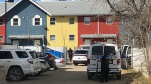 City police combing through the scene behind 219 Avenue K South in Saskatoon. Francois Biber/CTV News.