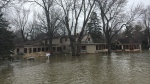The Red Cross is raising money to help victims of spring flooding in Quebec. Here, a home in Laval is seen surrounded by water on Sun., April 21, 2019. (Photo: Angela Mackenzie/CTV Montreal)