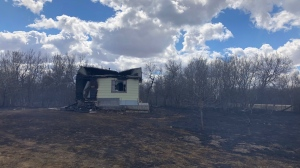 A home damaged in a brush fire west of Saskatoon on April 20, 2019.