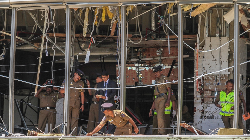 A Sri Lankan Police officer inspects a blast spot at the Shangri-la hotel in Colombo, Sri Lanka, Sunday, April 21, 2019. (AP Photo/Chamila Karunarathne)