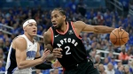 Toronto Raptors' Kawhi Leonard (2) drives to the basket against Orlando Magic's Aaron Gordon, left, during the first half in Game 4 of a first-round NBA basketball playoff series, Sunday, April 21, 2019, in Orlando, Fla. (AP Photo/John Raoux)