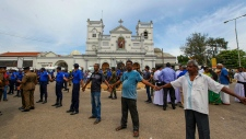 Sri Lankan army soldiers secure the area around St. Anthony's Shrine after a blast in Colombo, SriLanka, Sunday, April 21, 2019. More than hundred people were killed and hundreds more hospitalized from injuries in near simultaneous blasts that rocked three churches and three luxury hotels in Sri Lanka on Easter Sunday, a security official told The Associated Press, in the biggest violence in the South Asian country since its civil war ended a decade ago. (AP Photo/ Rohan Karunarathne )