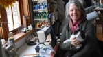 Elizabeth May's wedding dress designer Sue Earle and her cat Louie pose for a photo in her sewing room on Salt Spring Island, B.C. in this undated handout photo. THE CANADIAN PRESS/HO, Sue Earle