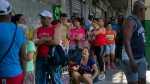 People wait in line to buy chicken at a government-run grocery store in Havana, Cuba, Wednesday, April 17, 2019. Hours-long lines appear within minutes when trucks show up with new supplies, and shelves are empty again within hours. (AP Photo/Ramon Espinosa)