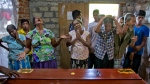 Relatives weep near the coffin with the remains of 12-year Sneha Savindi, who was a victim of Easter Sunday bombing at St. Sebastian Church, Monday, April 22, 2019 in Negombo, Sri Lanka. (AP Photo/Gemunu Amarasinghe)