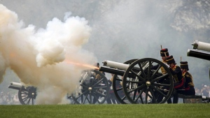 The King's Troop Royal Horse Artillery fire a 41 Gun Royal Salute to mark the 93rd birthday of Queen Elizabeth II, in Hyde Park, London, on April 22, 2019.  (Stefan Rousseau / PA via AP)