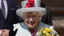 Queen Elizabeth II waves to the public