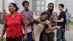 Relatives of a blast victim grieve outside a morgue in Colombo, Sri Lanka, Sunday, April 21, 2019. (AP Photo/Eranga Jayawardena)