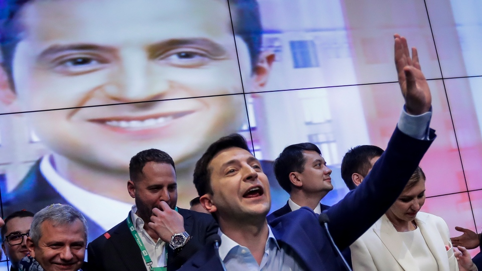 Volodymyr Zelenskiy gestures while speaking at his headquarters in Kyiv, Ukraine on Sunday, April 21, 2019. (AP Photo/Sergei Grits)