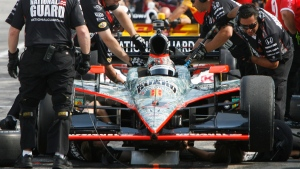 Crewmen work on the car of J.R. Hildebrand during the first practice session of the day for the MoveThatBlock.com IndyCar 225 auto race at New Hampshire Motor Speedway on Saturday, Aug. 13, 2011 in Loudon, N.H. (AP Photo/Toby Talbot)