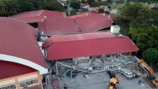 Collapsed building after quake hits Philippines