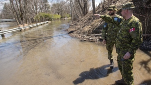 Canadian Forces personnel survey the rising flood waters in Laval, Que., on Sunday, April 21, 2019. THE CANADIAN PRESS/Ryan Remiorz