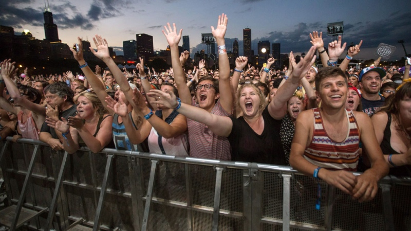 This Aug. 3, 2013 file photo shows fans reacting while Mumford & Sons performs at the Lollapalooza Festival in Chicago. (THE CANADIAN PRESS/AP/Scott Eisen, File)
