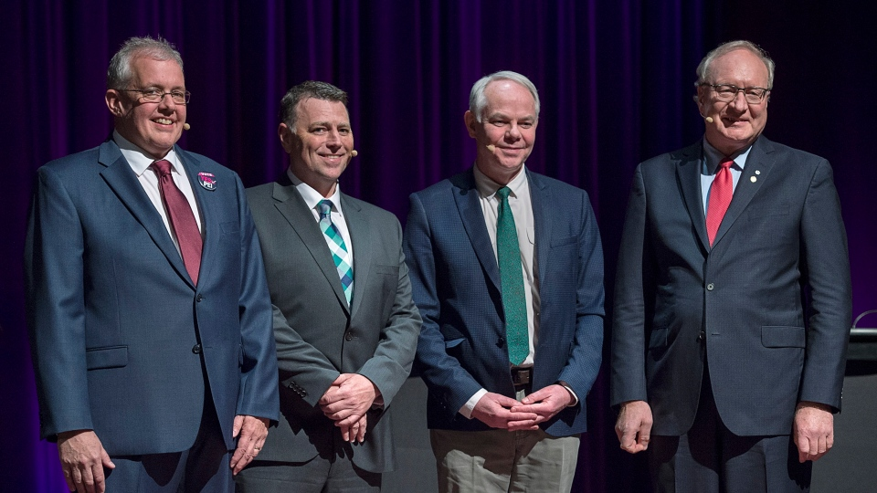 NDP Leader Joe Byrne, left to right, Progressive Conservative Leader Dennis King, Green Leader Peter Bevan-Baker and Liberal Leader Wade MacLauchlan pose for a photo at the provincial leaders debate at the Harbourfront Theatre in Summerside, P.E.I. on Tuesday, April 16, 2019. THE CANADIAN PRESS/Andrew Vaughan