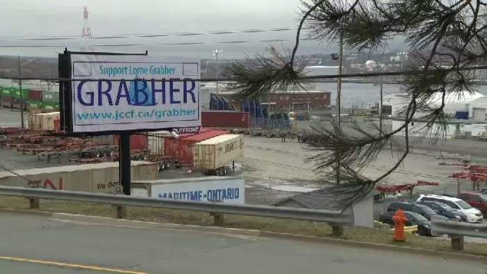 Lawyers for Lorne Grabher have purchased a $900 ad on billboard along Barrington Street.