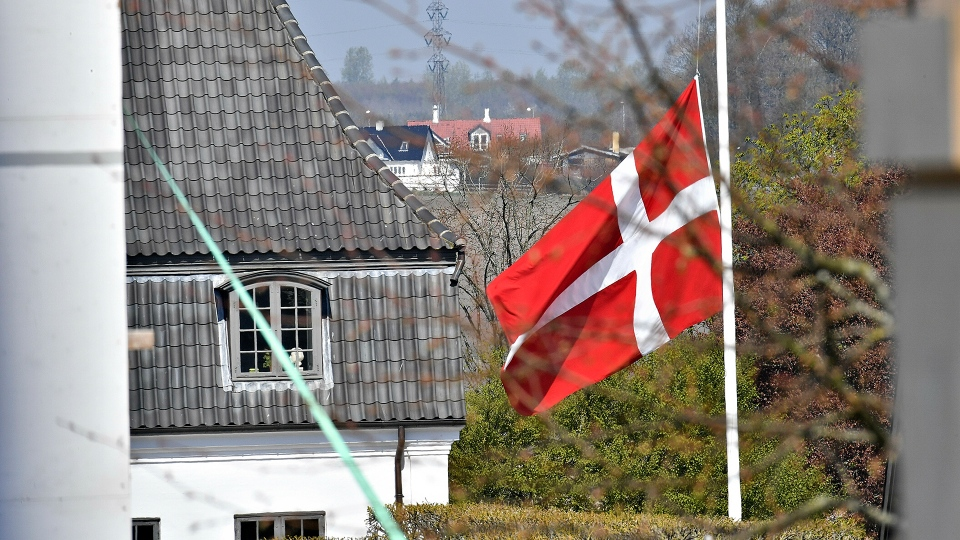 The flag is seen at half-mast at Danish billionaire and owner of fashion business Bestseller Anders Holch Povelsen's home south of Aarhus, Denmark, Monday, April 22. 2019. (Ernst van Norde / Ritzau Scanpix via AP)