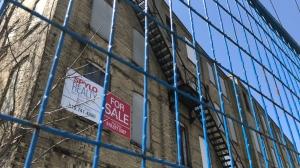 A 'for sale' sign seen on the former Electrohome building in Kitchener. (Dan Lauckner / CTV Kitchener)