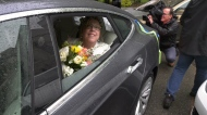 Elizabeth May leaves her Victoria wedding in a Tesla. (CTV Vancouver Island)