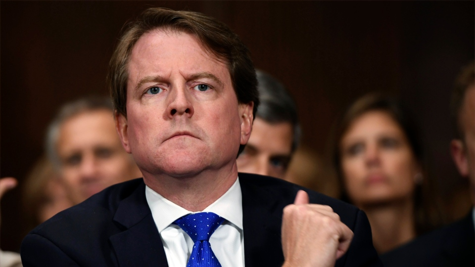 In this Sept. 27, 2018, file photo, White House counsel Don McGahn listens as Supreme court nominee Brett Kavanaugh testifies before the Senate Judiciary Committee on Capitol Hill in Washington. (Saul Loeb/Pool Photo via AP, File)