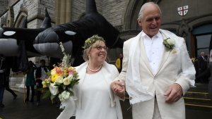 Federal Green Party leader Elizabeth May and her husband John Kidder greet the public following their marriage during Earth Day at the Christ Church Cathedral in Victoria, B.C., on Monday, April 22, 2019. THE CANADIAN PRESS/Chad Hipolito