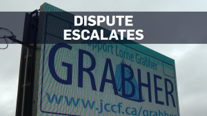 'GRABHER' plate dispute lawyers install billboards