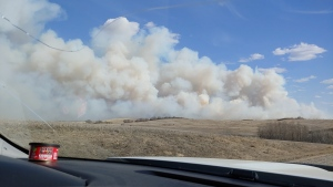 A grass fire burns southwest of Biggar. (Courtesy: Shirley Darrach)