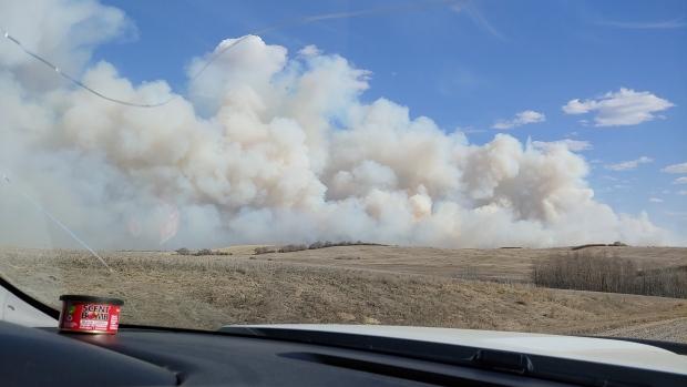 A grass fire burns southwest of Biggar. (Courtesy: Shirley Darrach)