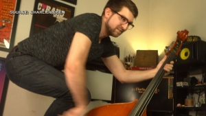 Broadway composer Charlie Rosen demonstrates his upright bass talents from an unusual position. (Charlie Rosen)