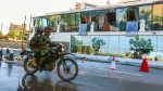 Sri Lankan Soldiers on a motorcycle drives past Kingsbury Hotel, which was attacked by a suicide bomber, in Colombo, Sri Lanka, Monday, April 22, 2019. A government crime investigator says the coordinated Easter bombings that ripped through Sri Lankan churches and luxury hotels were carried out by seven suicide bombers which killed and injured hundreds of people, was Sri Lanka's deadliest violence since a devastating civil war in the South Asian island nation ended a decade ago. (AP Photo/Chamila Karunarathne )