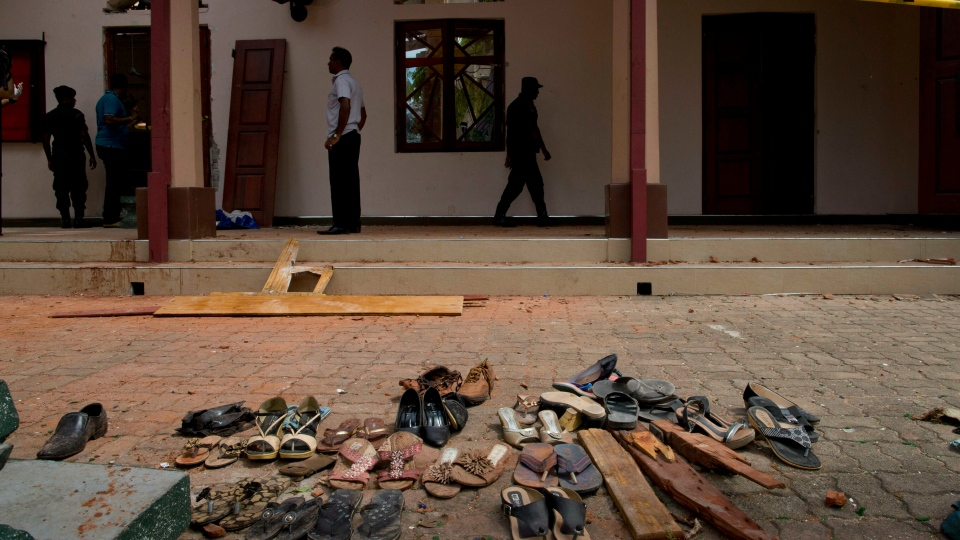 Footwear and personal belongs of victims kept close to the scene of a suicide bombing at St. Sebastian Church in Negombo, Sri Lanka, Monday, April 22, 2019. (AP Photo/Gemunu Amarasinghe)