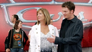 "FILE - In this May 26, 2006, file photo, NASCAR driver Dale Earnhardt Jr., right, and his mother Brenda Jackson, front left, arrive for the premiere of the Disney/Pixar animated film ""Cars"" at Lowe's Motor Speedway in Concord, N.C. (AP Photo/Chuck Burton, File)"