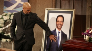 "This image released by CBS shows Shemar Moore portraying Malcolm Winters during a funeral scene for the character Neil Winters, portrayed by the late actor Kristoff St. John, in the daytime series ""The Young and the Restless."" (Michael Yarish/CBS via AP)"