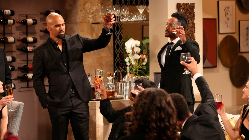"This image released by CBS shows Shemar Moore portraying Malcolm Winters, left, in a scene honoring the character Neil Winters, portrayed by the late actor Kristoff St. John, in the daytime series ""The Young and the Restless."" (Michael Yarish/CBS via AP)"