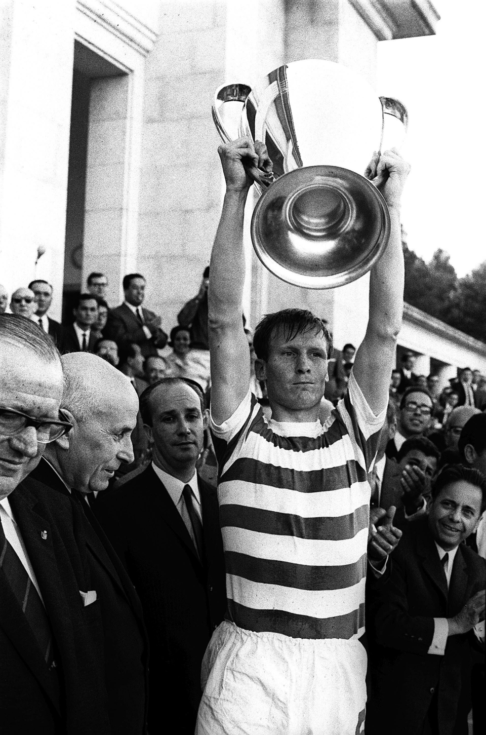 In this May 25, 1967 file photo Celtic soccer team captain Billy McNeill holds aloft the European Cup after it was presented by Portugal's President Americo Tomaz, left, in Lisbon, Portugal. Celtic defeated Inter-Milan 2-1 in the European Cup final.  (AP Photo, File)