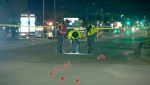 Police investigate at the scene of a fatal hit-and-run on 32nd Avenue N.E. in April.