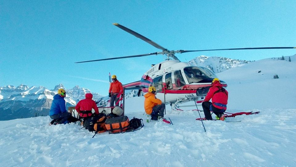 Searchers used helicopters and long lines to recover the bodies of three men killed in an avalanche after summitting Howse Peak.