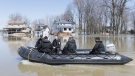 Members of the Naval Reserve patrol the Rigaud river next to homes surrounded by floodwaters in the town of Rigaud, Que, west of Montreal, Monday, April 22, 2019. THE CANADIAN PRESS/Graham Hughes