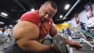 Egyptian body builder Moustafa Ismail works out in Milford, Mass., on Nov. 16, 2012. (Stephan Savoia / AP)